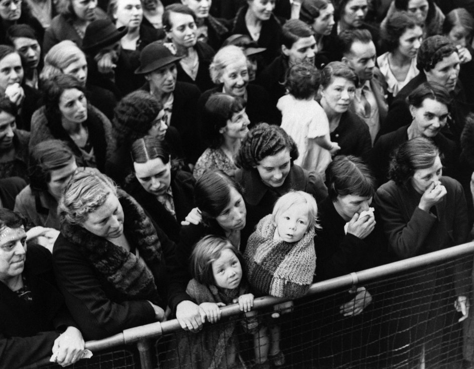 London began evacuating 3, 000, 000 women, children and infirm on September 1 as undeclared war flared across Poland. A group as they hurriedly left the city in a railroad car Sept. 1, 1939 as fears of war mounted. (AP Photo). Keywords: Crowd Childhood Standing Looking Away