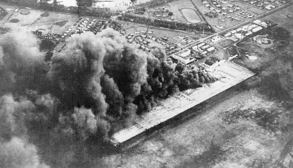 RB PLUS Japan og USA mindes Pearl Harbor sammen- - Wheeler Army Airfield, also known as Wheeler Field and formerly as Wheeler Air Force Base, is seen under attack by the Imperial Japanese Navy in Pearl Harbor in Honolulu, Hawaii, in this December 7, 1941 file photo released by Kyodo. Mandatory credit Kyodo/via REUTERS ATTENTION EDITORS - THIS IMAGE WAS PROVIDED BY A THIRD PARTY. EDITORIAL USE ONLY. MANDATORY CREDIT. JAPAN OUT.NO COMMERCIAL OR EDITORIAL SALES IN JAPAN.