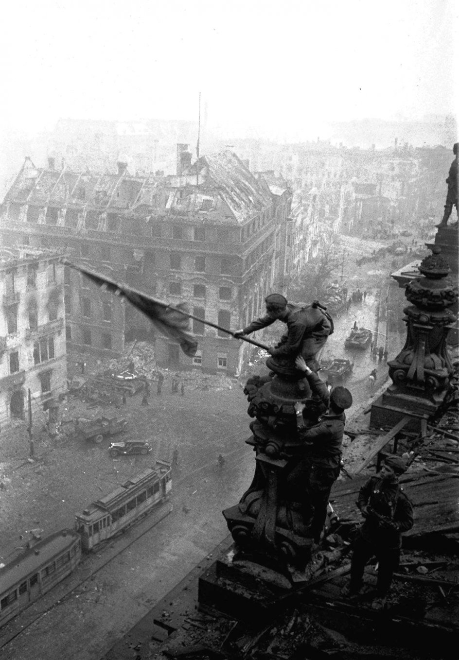 FILE- In this May 2, 1945 file photo, Soviet soldiers hoist the red flag over the Reichstag after the fall of Berlin, which became one of the iconic images of World War II taken by renowned photographer Yevgeni Khaldei. The daughter of the photographer Yevgeni Khaldei who took the iconic WWII image of Red Army soldiers atop the Reichstag, Anna Khaldei has regained possession of his original negatives after a 15-year court battle and is now hoping to mount an exhibition of her father's work, recording history through his lens. (Yevgeni Khaldei/ITAR-TASS file photo via AP)