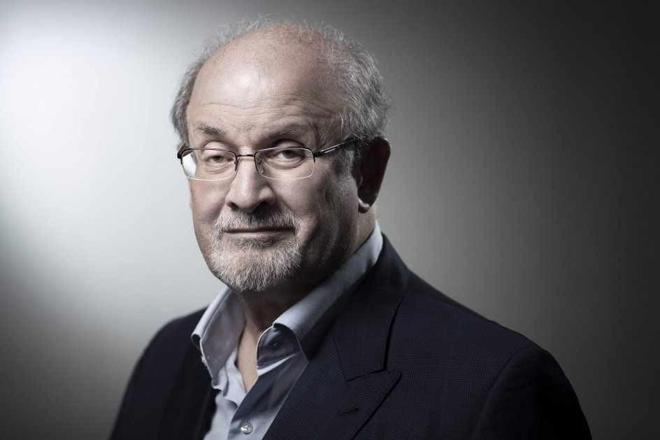 """(FILES) In this file photo taken on September 10, 2018 now US novelist and essayist Salman Rushdie poses during a photo session in Paris. - The author of the """"Satanic Verses"""", now US novelist and essayist Salman Rushdie, refuses to live as a recluse but he accepted to live under police protection since the Ayatollah Khomeini, the first guide of the Islamic Republic of Iran put a fatwa on a him and condemned him to death sentence for the book deemed as blasphemous by Muslims. (Photo by JOEL SAGET / AFP)"""