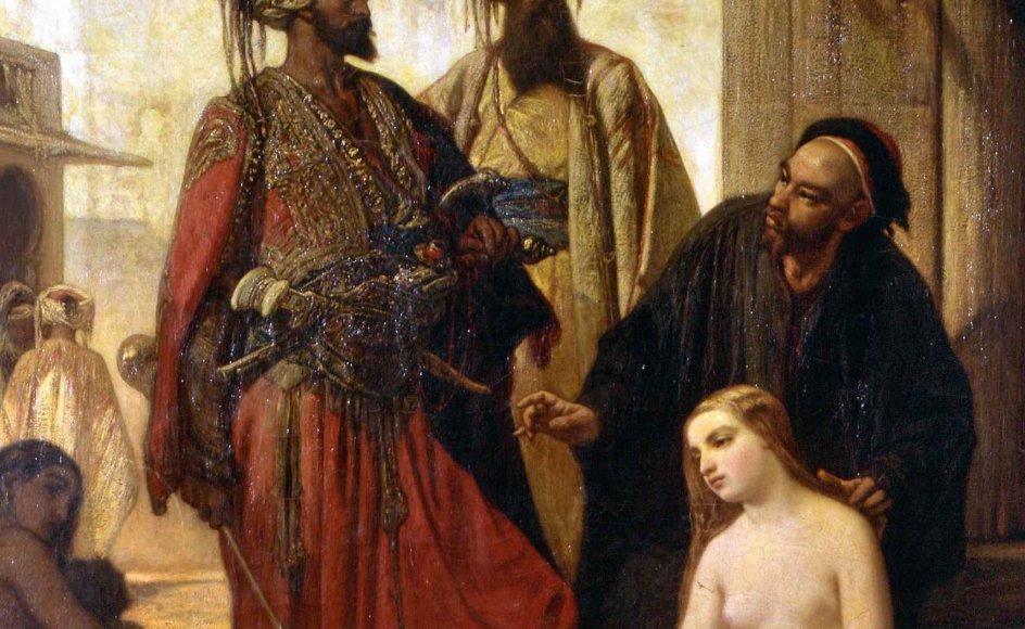 """På et berømt maleri af Louis Devedeux fra 1800-tallet ses hvide slaver foran arabiske slavehandlere. Billedet hedder """"Et slavemarked i Lilleasien"""". –"""