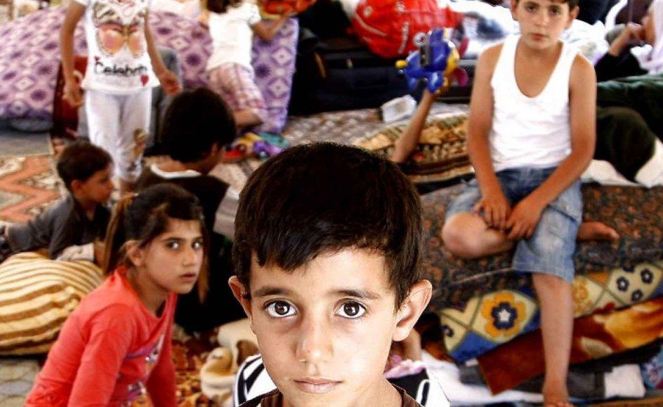 Yazidierne følger en religion fra gammel tid, der trækker tråde til både den persiske zarathustra-religion og islamisk sufisme. Foto fra flygtningelejr i Irak ved grænsen til Tyrkiet: EPA
