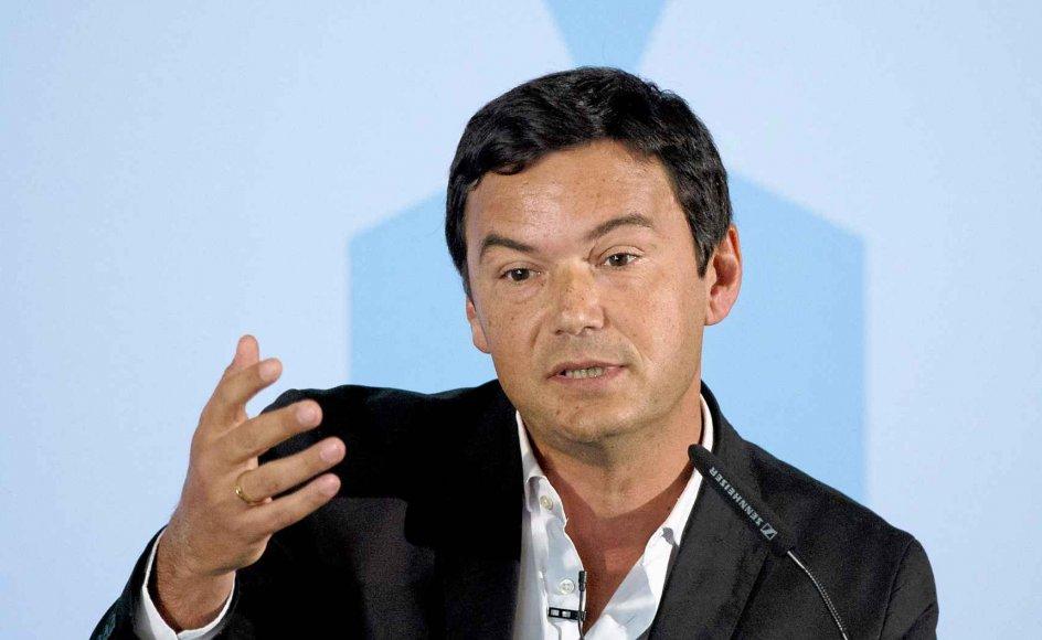 """Thomas Pikettys """"Kapitalen i det 21. århundrede"""" er simpelthen en af de mest savnede bøger i årtier, mener Asger Brandt. Her deltager Piketty i et arrangement i økonoministeriet i Berlin tidligere i denne måned, hvor man blandt andet diskuterede økonomisk ulighed. -"""