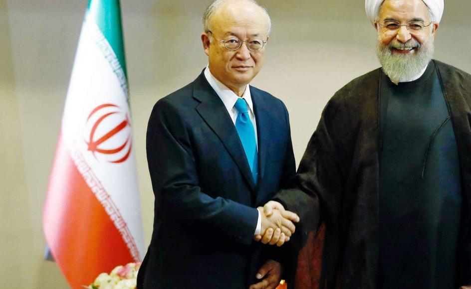 Yukiya Amano, generaldirektør for FN's atomenergiagentur, sammen med den iranske præsident, Hassan Rouhani.-