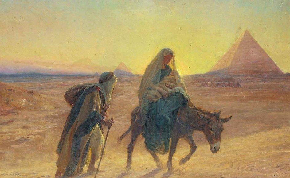 Ørkenen er del af mange fortællinger i Bibelen. Her er det den hellige familie, der er på flugt i Egypten med pyramider i baggrunden. Værket er af den franske maler Eugene Alexis (1853-1907). – Foto: Bridgeman Images/Ritzau Scanpix.