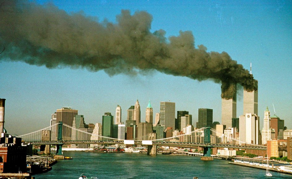 Smoke is seen at the towers of the World Trade Center shortly after being struck by a hijacked commercial aircraft, in New York, U.S., September 11, 2001. REUTERS/Brad Rickerby