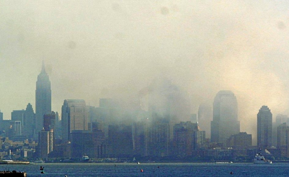 Lower Manhattan and the Statue of Liberty are seen from Staten Island 12 September 2001 as smoke continues to rise from the rubble of the World Trade Center towers. The buildings collapsed 11 September following a terrorist attack.   AFP PHOTO Doug KANTER
